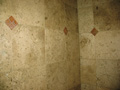 Bath tile mosaics installed in Travertine